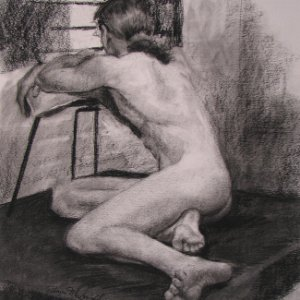 charcoal drawing of nude male figure's back