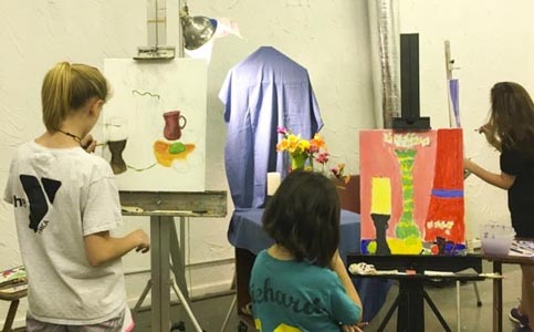 Allison Doke's art discovery art class with middle school students painting still life