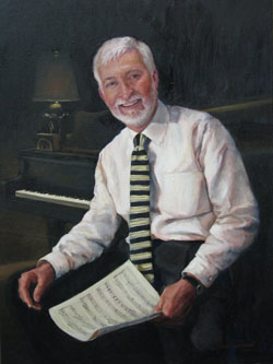 portrait of a man with white hair wearing a light pink shirt and a black striped tie in front of the keyboard of a piano